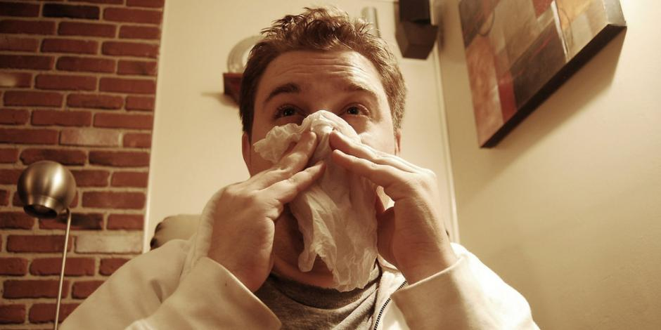 Man wiping nose